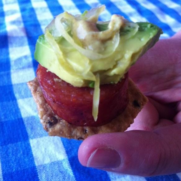 sausage on cracker with avocado