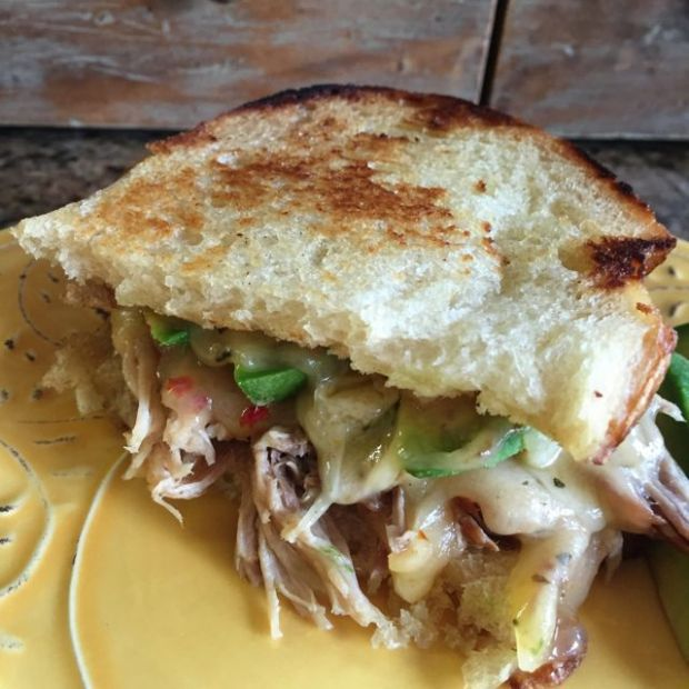 Elevated grilled cheese sandwich with pulled pork and California avocado with Cabot tomato basil cheddar.