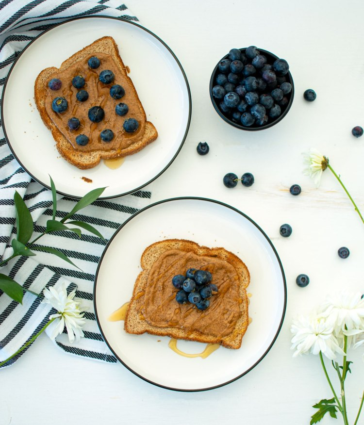 The best easy and healthy breakfast recipe, Blueberry Honey Almond Butter Toast. This easy and adaptable breakfast recipe is healthy with almond butter, honey, and fresh blueberries. A perfect toast recipe you'll want to make every day #organictoast #toast #toasttoppings #almondbutter #blueberry #honeyalmond #healthyrecipe #healthybreakfast #breakfastrecipe