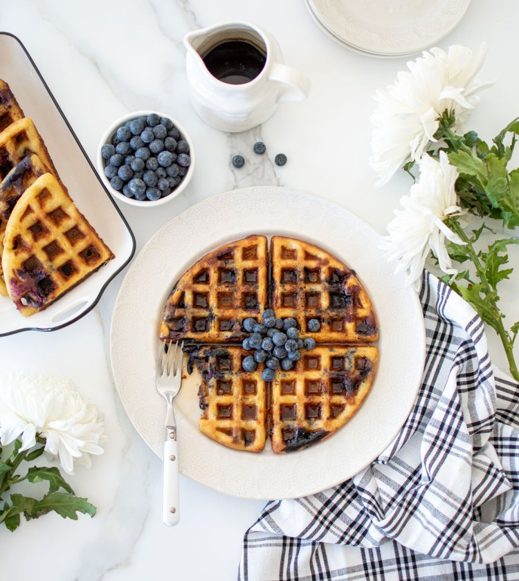 Homemade Blueberry Waffle recipe that your whole family will love! Easy and oh so yummy from scratch homemade Blueberry Waffle recipe. I used fresh blueberries in these waffles for bursting blueberry flavor in every bite. Make these homemade waffles this weekend! #organicwaffles #waffles #homemadewaffles #blueberrywaffles #organiccooking #organicblueberries #organicingredients #brunchrecipe #breakfastrecipe