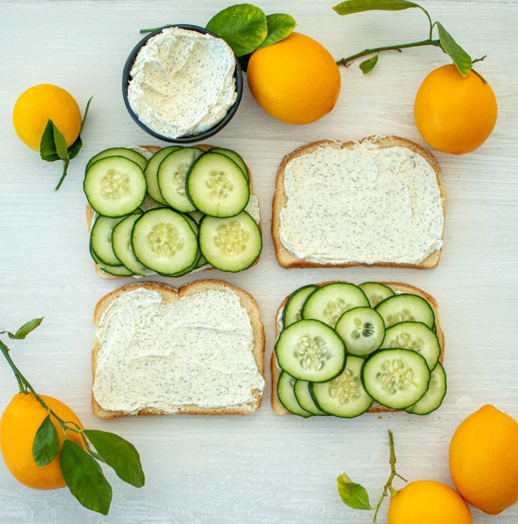 Easy and simple organic Cucumber Sandwich recipe. This 3 ingredient cucumber sandwich recipe is so easy and delicious! Made with a Dill Cream Cheese Spread in place of butter for a sweet tang that everyone will love! #cucumber #cucumbersandwich #organic #organiclunch #teatime #snacktime #organicsnacks #snackrecipes #cucumbers #dillcreamcheese