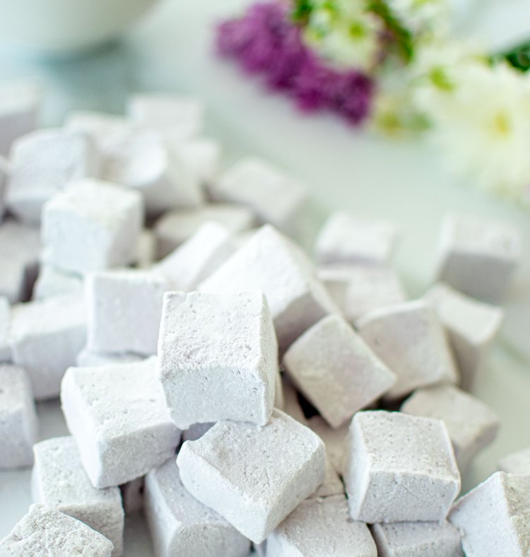 Homemade marshmallows made without corn syrup. These Honey Lavender Marshmallows are such an easy and delicious Easter recipe to make at home! #organicmarshmallows #homemademarshmallows #lavender #honeylavender #lavendermarshmallows