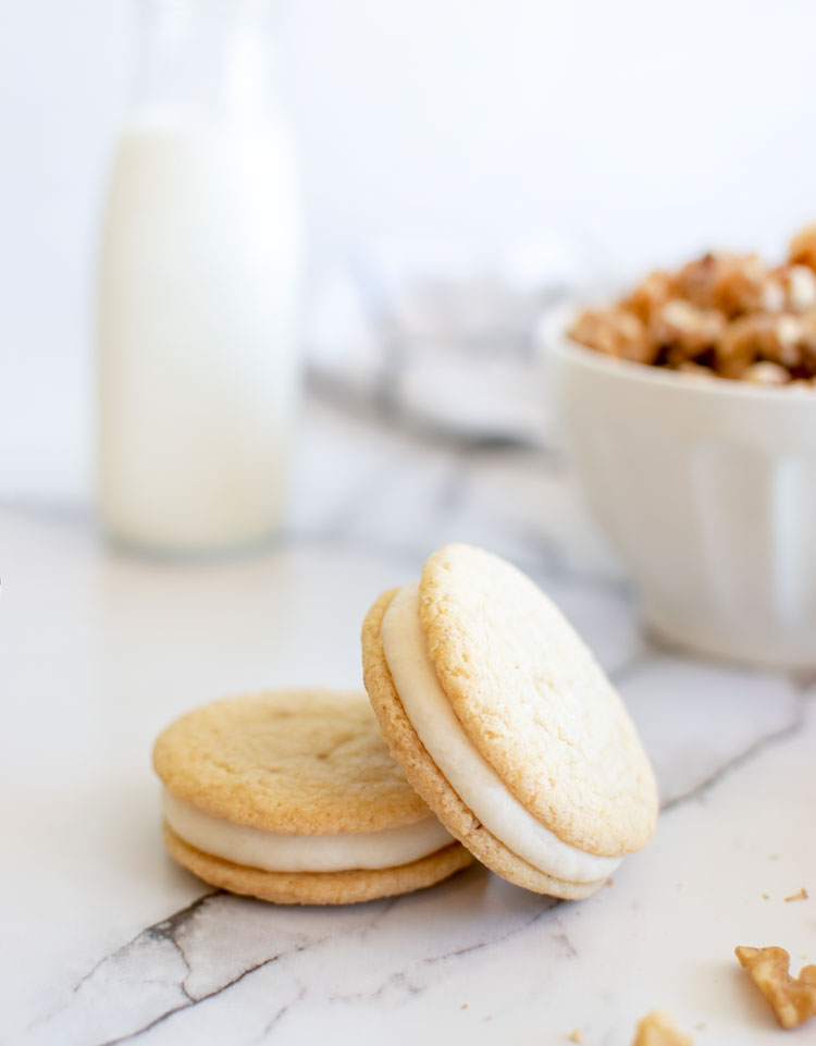Easy and healthy maple walnut sandwich cookie recipe, cookie recipe, sandwich cookies, sandwich cookie recipe, maple syrup recipe, walnut recipe, holiday cookies, christmas cookies, holiday baking, christmas cookie recipe #sandwichcookies #cookies #maplesyrup #maplewalnut #holidaycookies #christmascookies #cookiebox