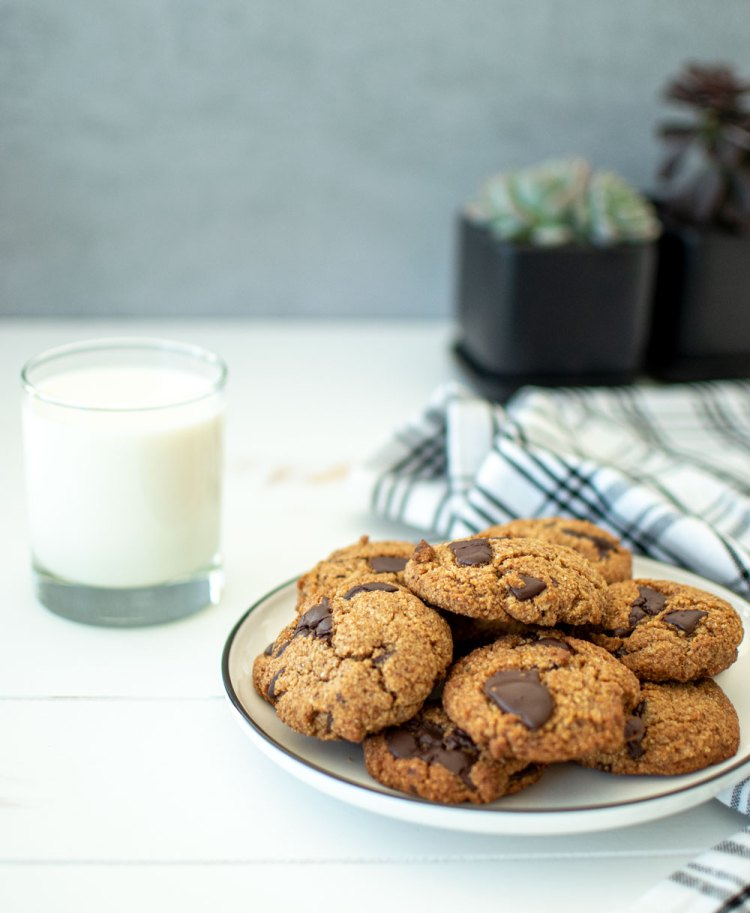 Easy paleo chocolate chip cookie recipe, this Paleo Dark Chocolate Chunk Cookie recipe is naturally gluten free and dairy free. This healthy chocolate chip cookie recipe is paleo friendly, delicious and hearty. #organiccookies #cookierecipe #paleocookies #paleofriendly #paleorecipe #chocolatechipcookies #chocolatechiprecipe #highaltitudebaking #glutenfree #glutenfreecookies #dairyfree #dairyfreecookies
