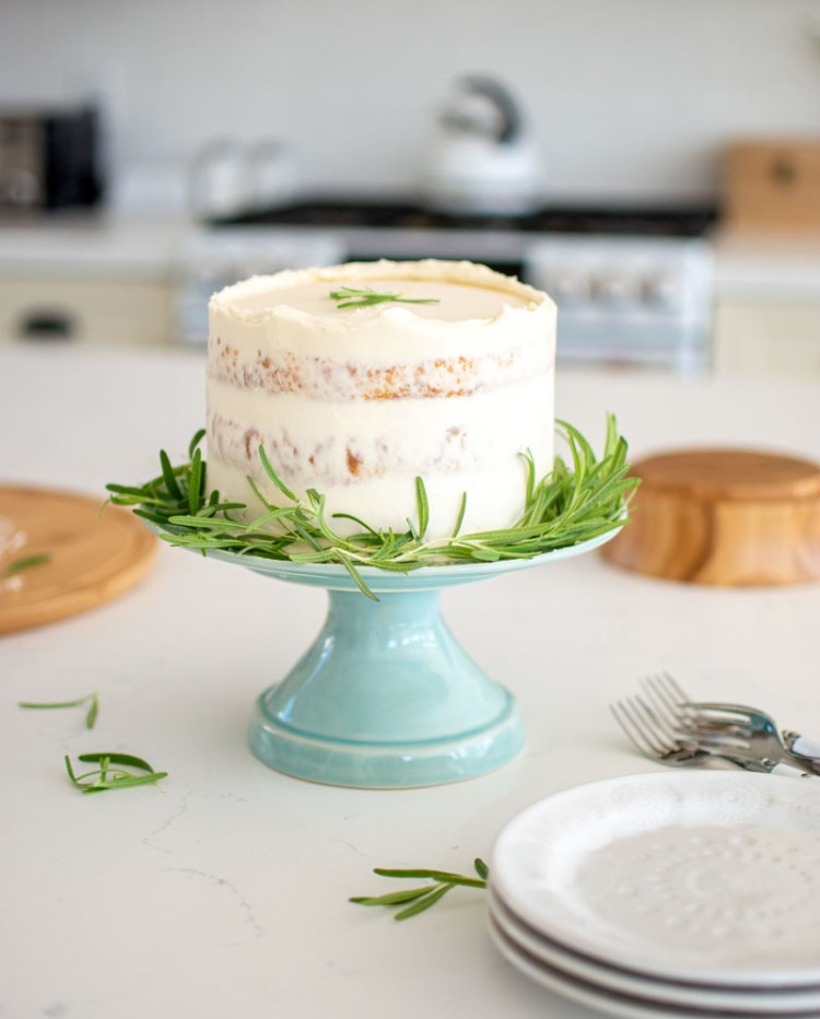 A holiday cake you're sure to love! This Rosemary Cake is simply festive, sweet and savory will impress all your holiday guests! Easy and delicious Christmas cake recipe #christmas #cake #christmascake #holiday #holidaycake #rosemary #vanillacake #glutenfreecake #highaltitudebaking #festive #festivecake #seasonal
