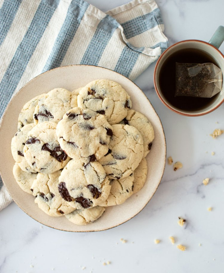 Healthy Salted Dark Chocolate Almond Cookies that are naturally gluten free! This simple and healthy cookie recipe is all you need to please everyone. Get this easy recipe for a twist on classic chocolate chip cookies #cookies #organic #organiccookies #glutenfree #glutenfreecookies #darkchocolate #darkchocolatealmond #almond #almondflour