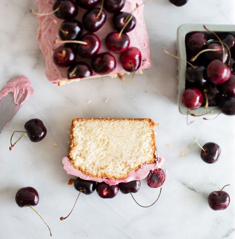 Delicious Sweet Cherry Loaf Cake recipe that will impress any guests! This yummy cherry cake is made using fresh cherries and is naturally dyed using fresh cherry juice. Topped with fresh cherries this cake is show stopper that will impress any party guests, plus it tastes amazing! #freshcherries #cherryseason #inseason #seasonal #cherrycake #oragniccake #highaltitudebaking
