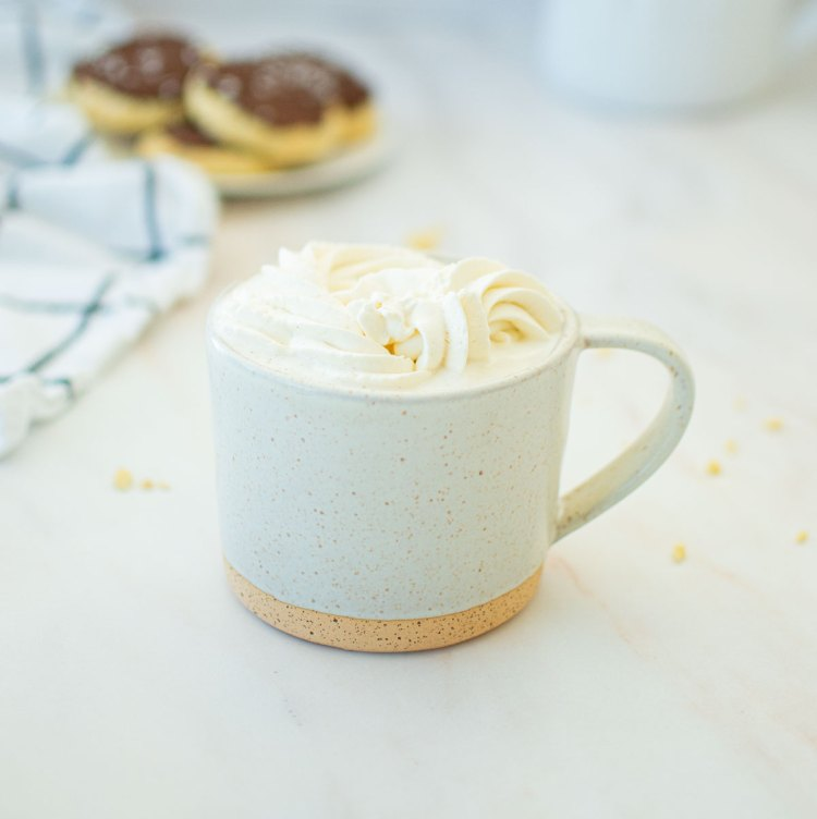 Homemade Vanilla Steamer recipe that's better than a coffee shop! I use ground vanilla bean in my vanilla steamer recipe for an authentic vanilla flavor and top it with homemade whipped cream. #vanillasteamer #homemadewhippedcream #coffeeshopdrinks #copycatvanillasteamer
