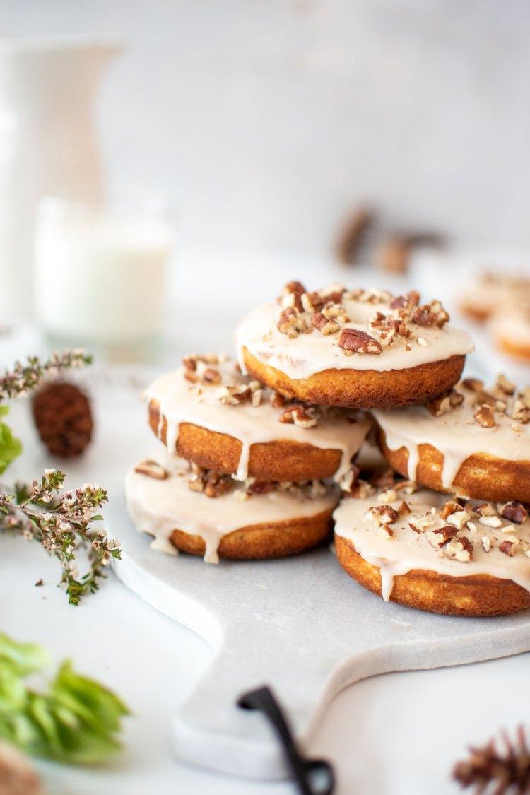The best Maple Pecan Baked Donut recipe. Easy baked donut recipe. Maple pecan donut recipe. High altitude donut recipe. Fall inspired donut recipe. Maple pecan homemade donut recipe. From scratch baked donuts. Homemade maple pecan donut recipe.