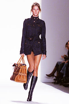 Gisele Bundchen opening the Luella show holding her namesake Fall 2002 (via style.com)