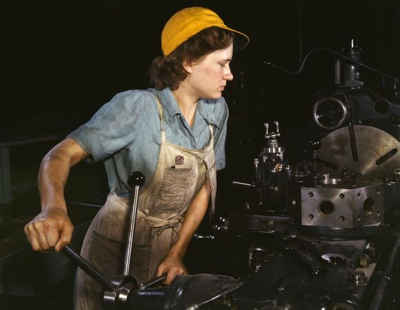 A woman operating a turret lathe (1942) photo Howard R. Hollem