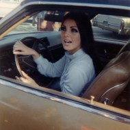 Priscilla Presley '60 in the car at Graceland