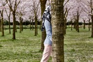 "Headless girl walking at the park. Photography Wendelien Daan. Silk scarf ""stallion""; Mimi Berlin, clohes models own."