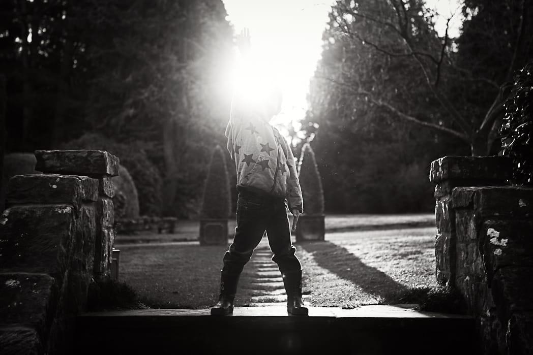 Little boy punching the sun