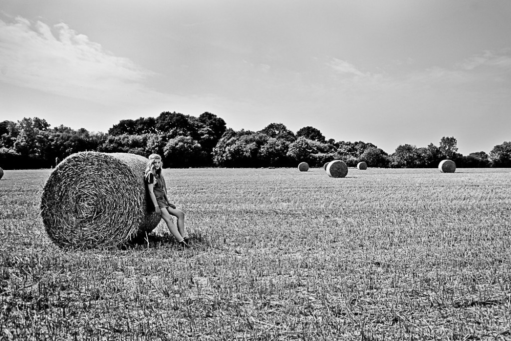 Girl in hay bale field