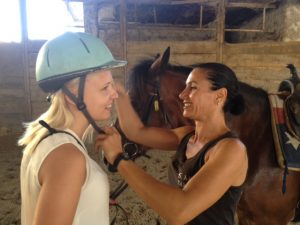 preparing for a horseback riding tour