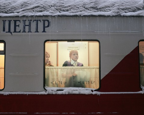 Patients wait for their medical treatment and laboratory results in the narrow gangways of the train. Kuragino, Krasnoyarsk Krai, Russia, 13.11.2016.