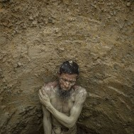Balukhali-Kutupalong refugee camp, Ukhia subdistrict, Cox's Bazar, Bangladesh 16/08/2018 - Sixty-year-old Abdul Salam inside a hole he excavated to build a latrine. The inability to manage the massive quantity of waste generated by the camps is a major source of disease. The World Health Organisation reported in December 2017 that 88 percent of the water samples it had collected from households in the camps were contaminated by the bacteria E. coli from unmanaged faecal matter.