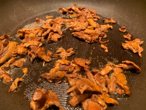 Chanterelles cooking in a non stick skillet.