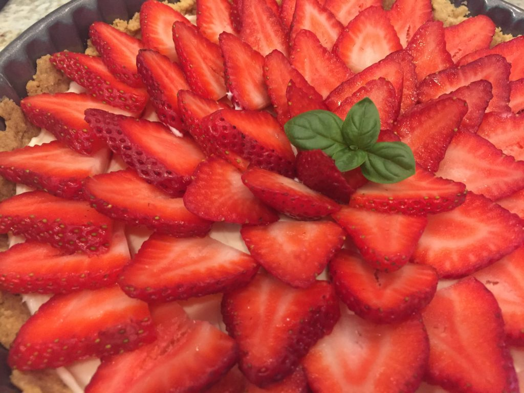 strawberry tart with basil garnish