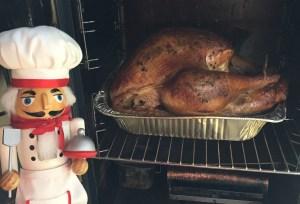 Pepe checking the turkey while it smokes