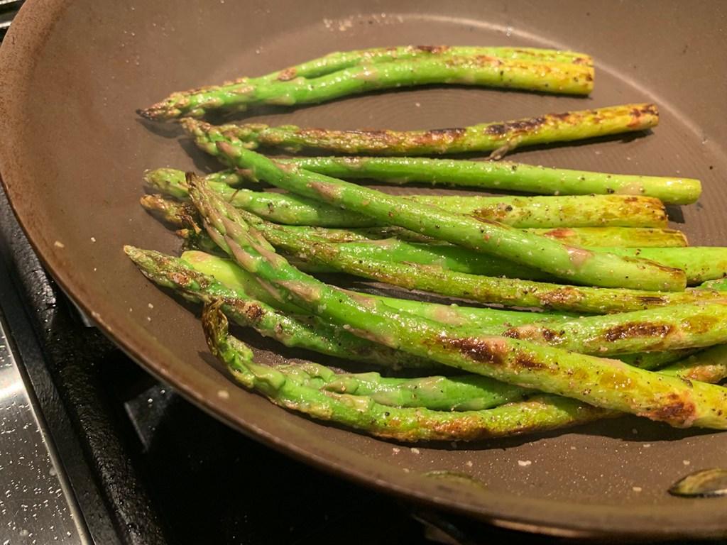 asparagus sautéing in a nonstick skillet