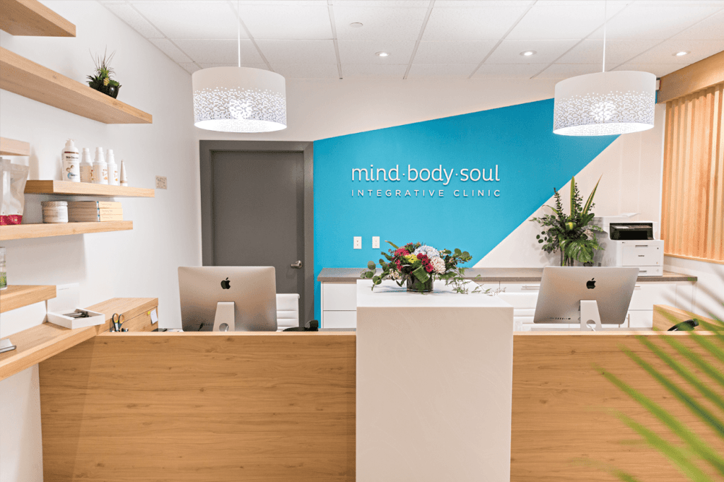 Mind Body Soul Integrative Clinic Sign in brightly lit office; highlighting the open house event