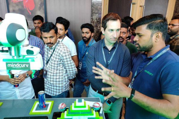Mindcurv staff sharing his expertise to visitor at Mindcurv's booth during the AWS Cochin event