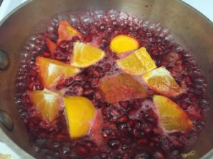 Pomegranates and mandarins and simmering