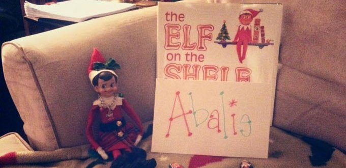 """Elf on the shelf"" on a couch"