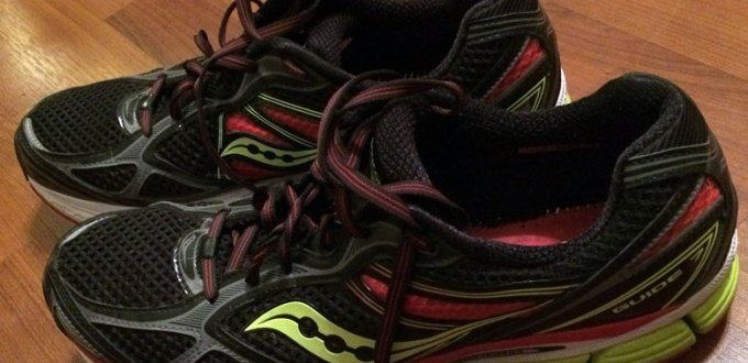 Black, red, and neon green running shoes.