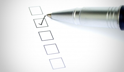 Image of a pen marking one of five checkboxes.