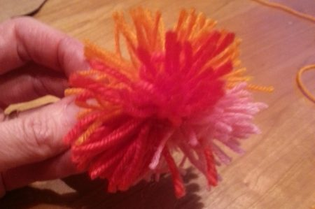 How to make a yarn pom pom www.mindfulmomma.com