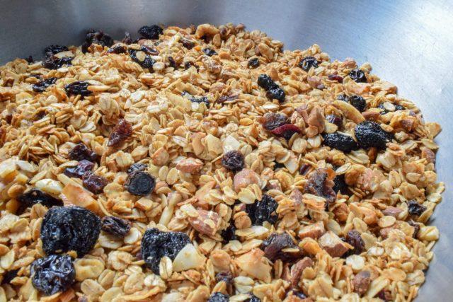 Homemade fruit & nut granola in metal bowl
