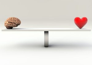 Balance Concept of an brain and an heart on a Seesaw