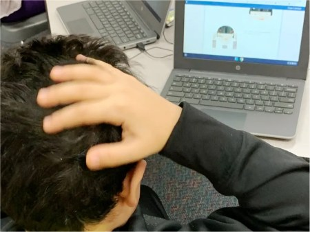 Student doing Brain Massage