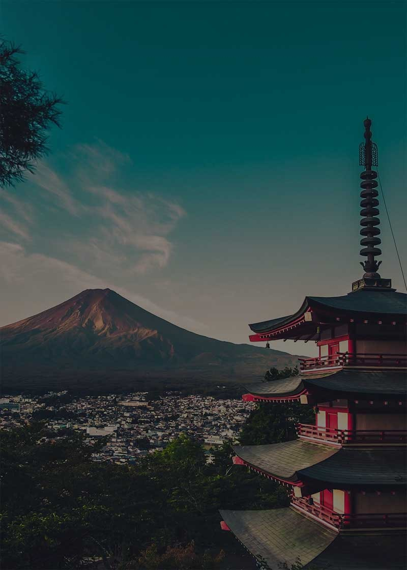 mount fuji in distance with view of a pagoda