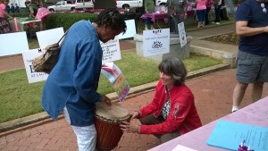 Trying out the djembe at Paint the Town Pink 2014