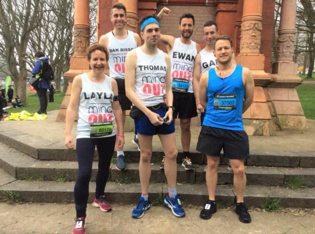 marathon runners in mindout vests gathered in preston park, brighton