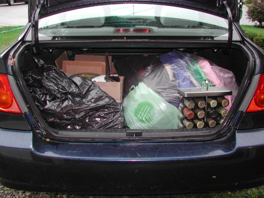 Car trunk full of bags of things to donate