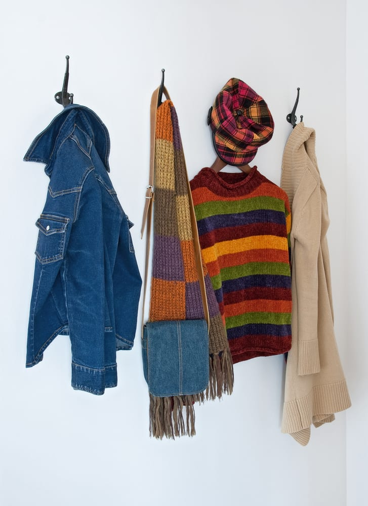 Colorful clothing on coat hooks