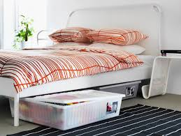 Slide bins under the bed for storage