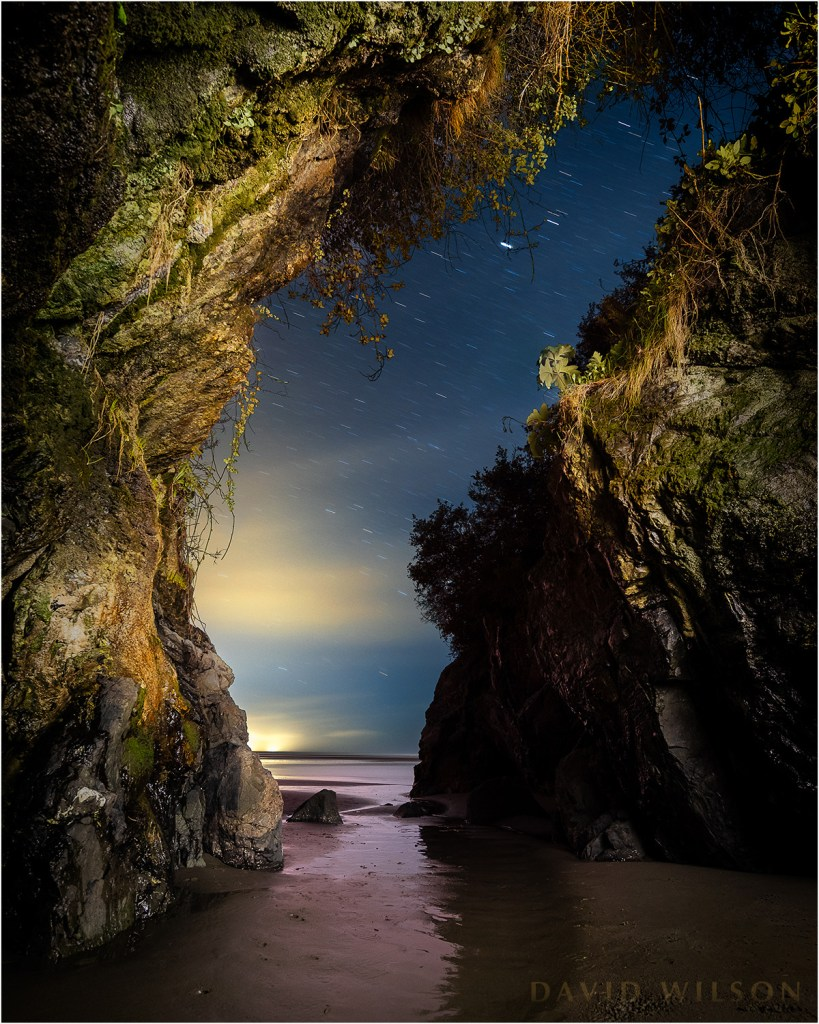 Looking out through the mouth of the Moonstone Beach cave into the night.