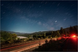 View across US 101 and Eel River valley beneath star trails