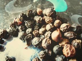 Whole black peppercorns (guta jhaluk in Assamese or gol mirch in Hindi)