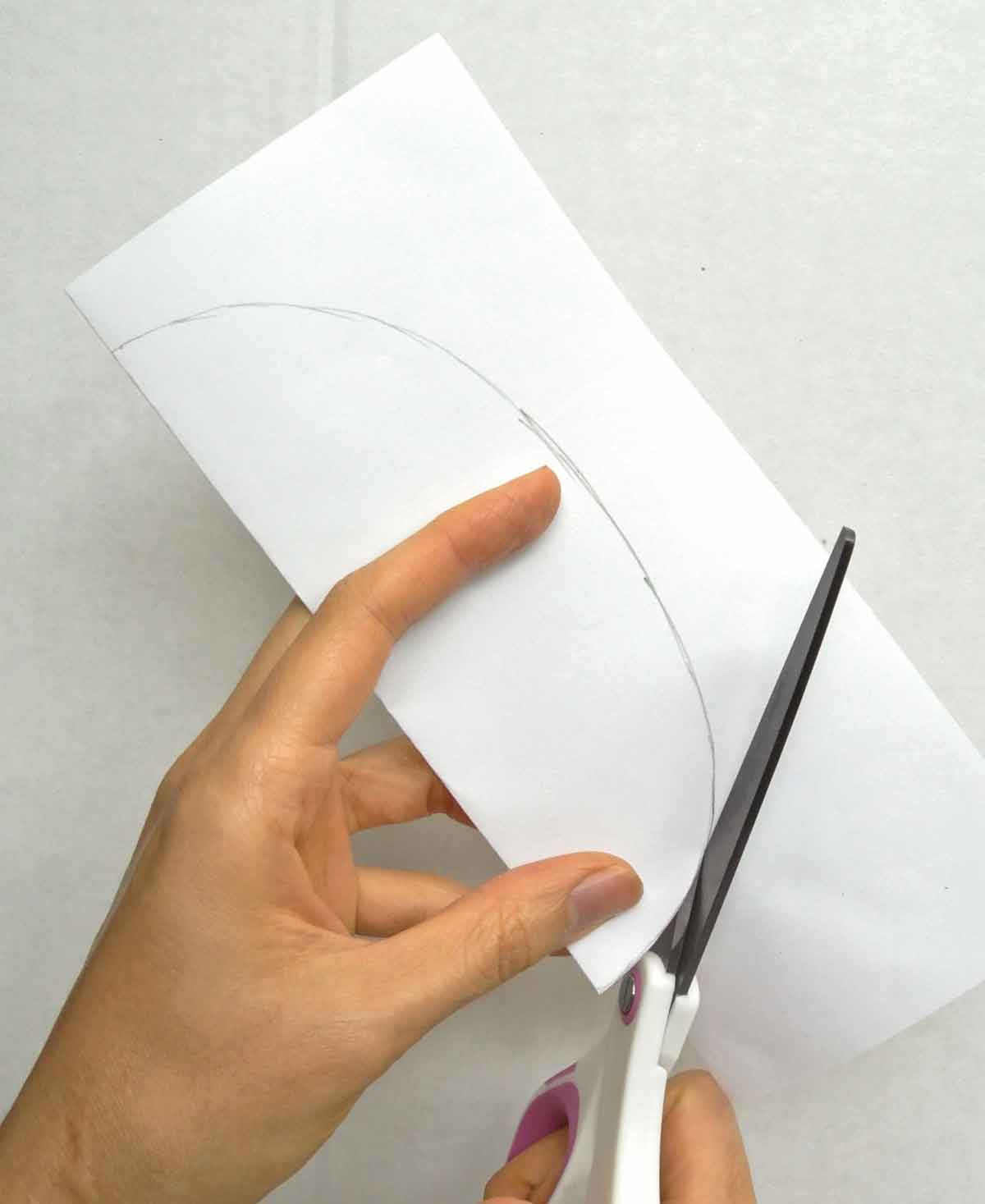 Cutting bear belly (accessory pattern) on fold of paper with scissors. How to Make Plushie Tutorial
