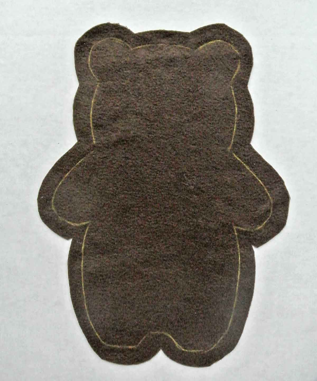 Bear Plush Fabric with pattern traced in yellow chalk and a border cut around for seam allowance. How to Make Plushie Tutorial