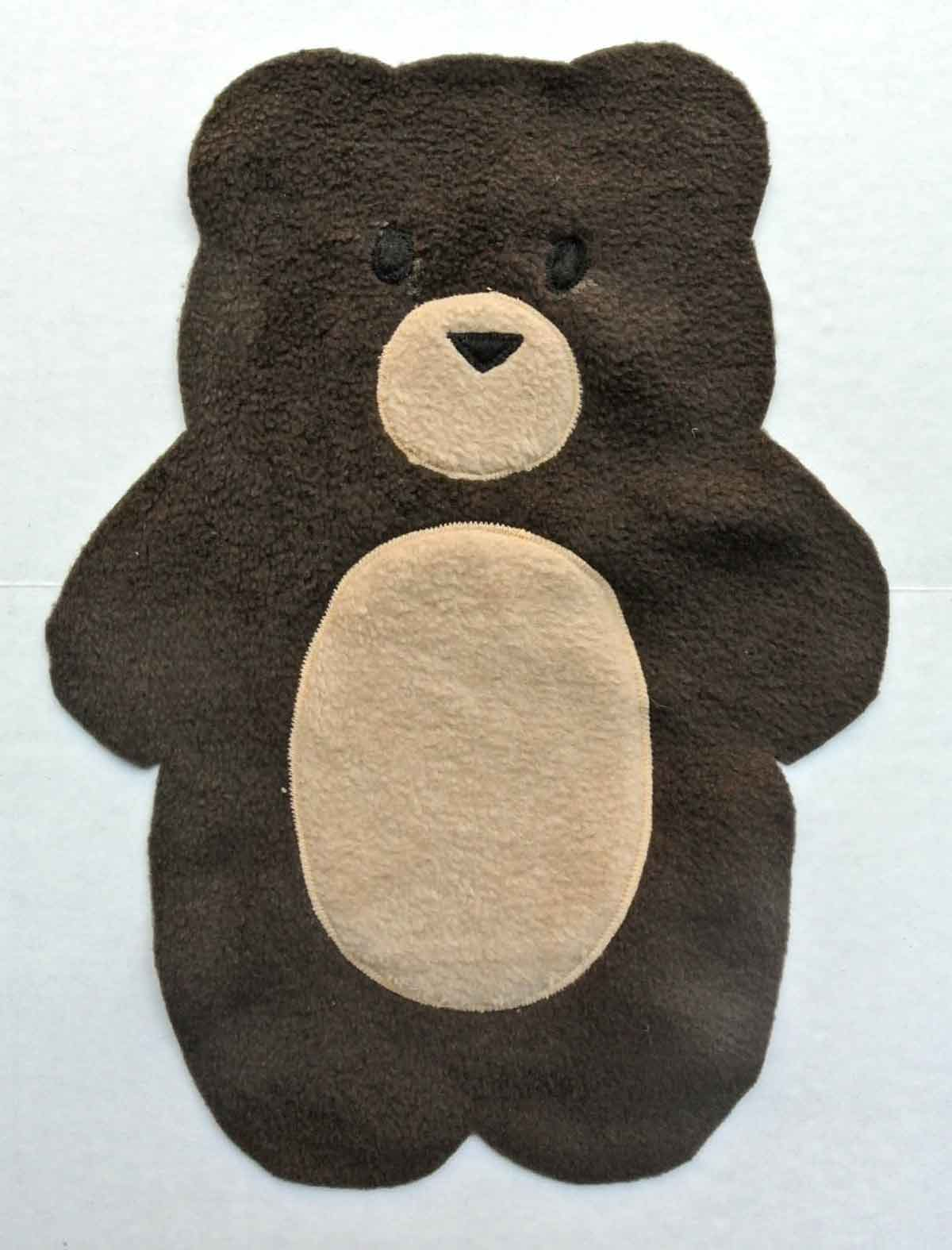 Bear plush front fabric with accessory details appliqued on. How to Make Plushie Tutorial