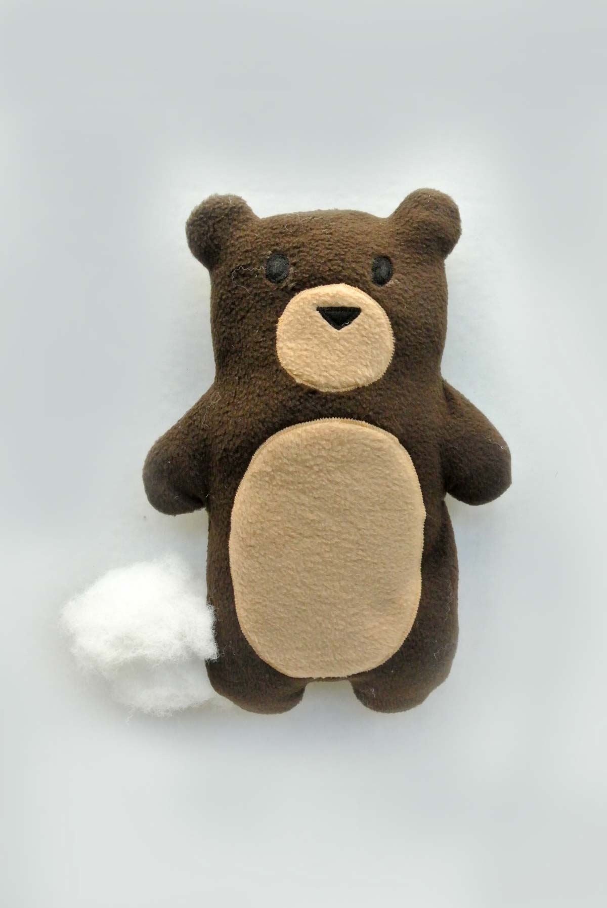Shows Bear Plush being stuffed with Polyester fiberfill. How to Make Plushie Tutorial