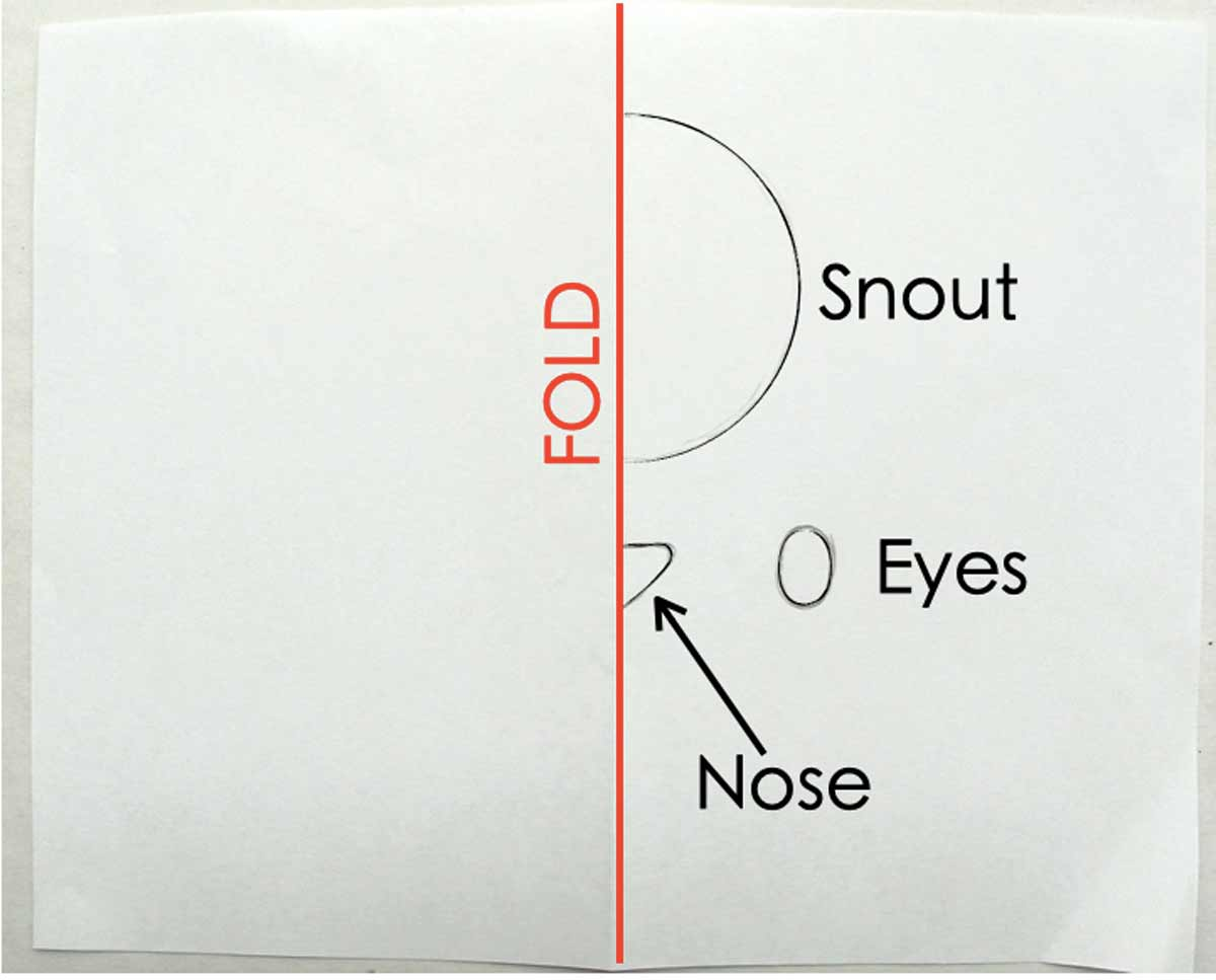 Displays folded piece of paper with snout, eyes, and nose. How to Make Plushie Tutorial